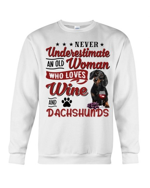 Never underestimate an old woman who loves wine and dachshunds Sweatshirt