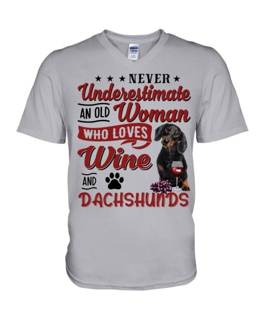 Never underestimate an old woman who loves wine and dachshunds V-neck