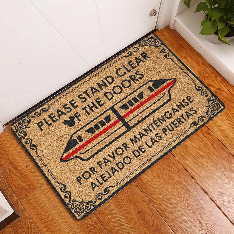 Please stand clear of the doors por favor mantengase alejado de las puertas doormat