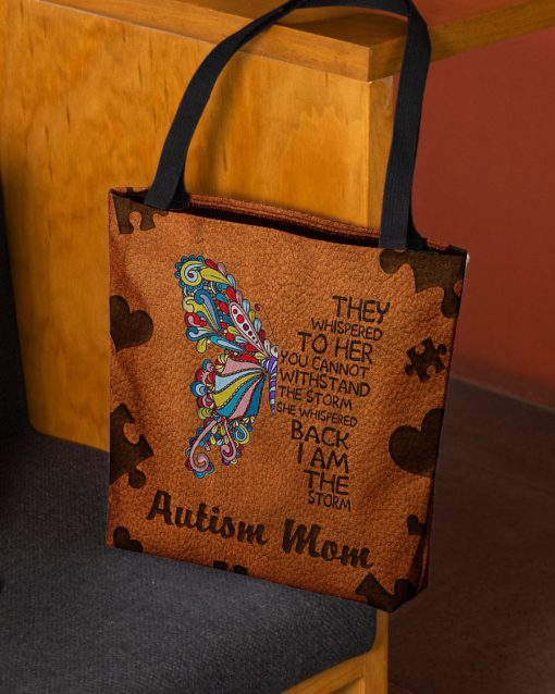 Autism mom They whispered to her you cannot withstand the storm she whispered back I am the storm tote bag 1