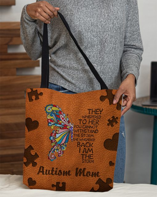 Autism mom They whispered to her you cannot withstand the storm she whispered back I am the storm tote bag 2