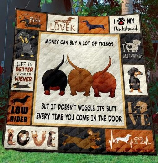 Money can buy a lot of things but it doesn't wiggle its butt every time you come in the door Dachshund Quilt 1